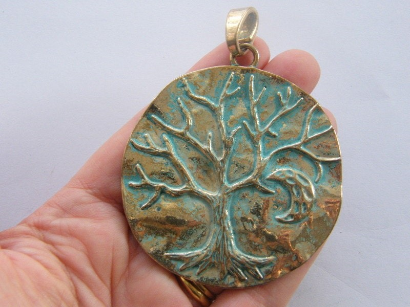 1 Tree charm blue and  antique gold tone GC49