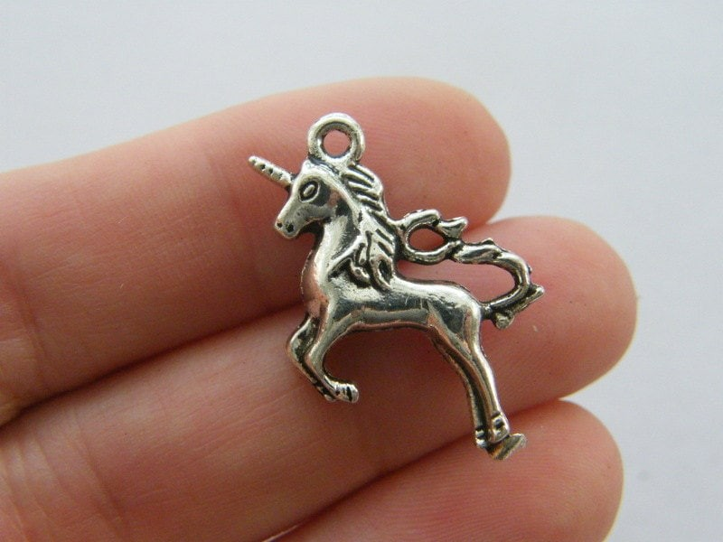 4 Unicorn charms antique silver tone A498