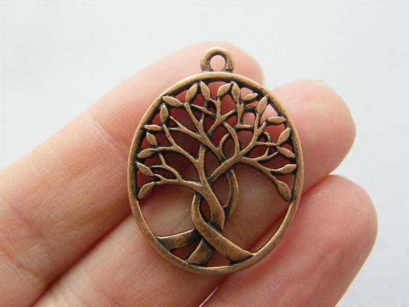 4 Tree pendants antique copper tone CC8