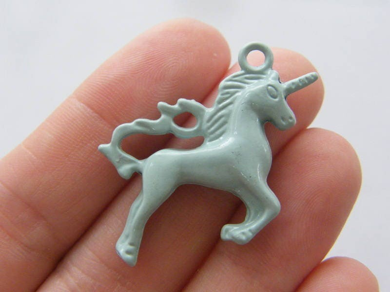 4 Unicorn charms mint green tone A663