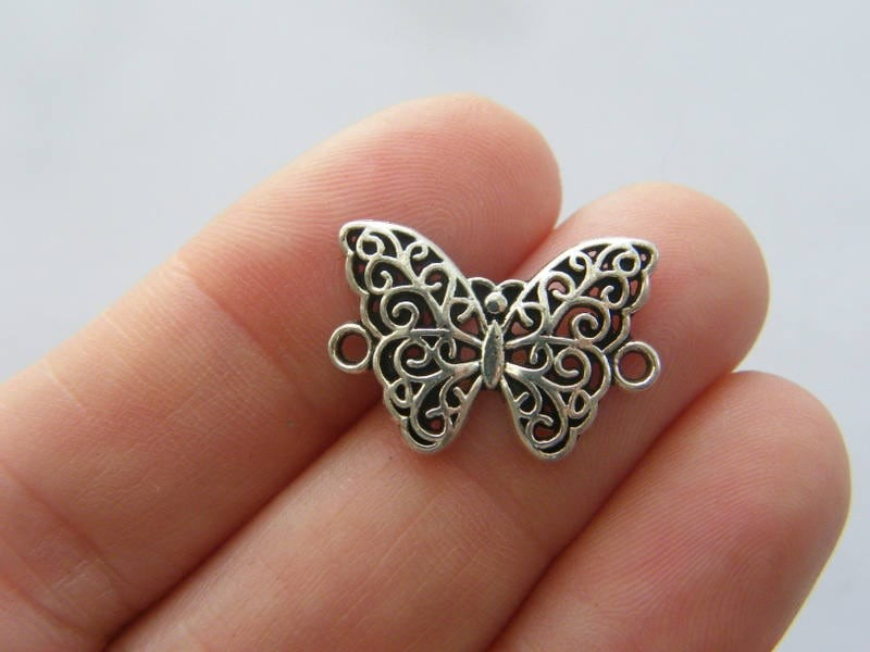 10 Butterfly connector charms antique silver tone A389