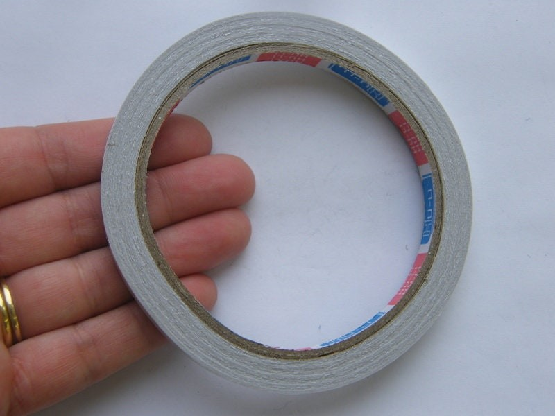 1 Roll double sided tape  14 meter x 0.8cm TP10