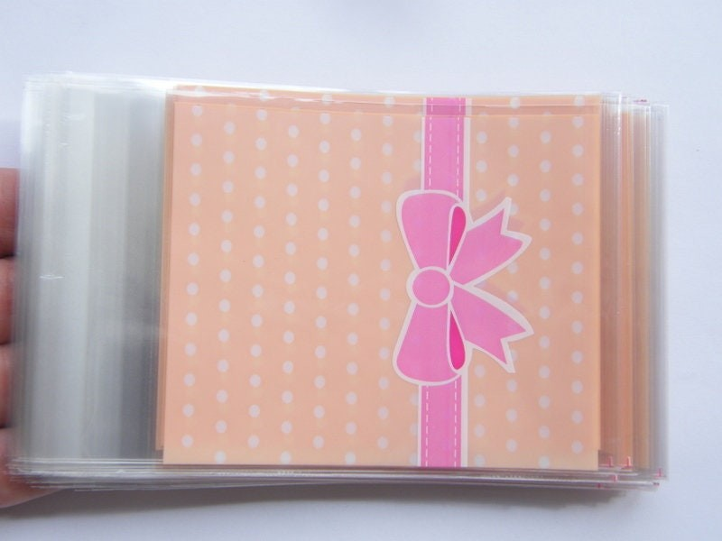 100 Light peach dots and pink bow cellophane packet bags - self sealing and resealable