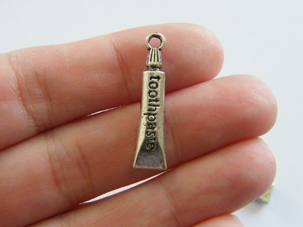 8 Toothpaste charms antique silver tone MD40
