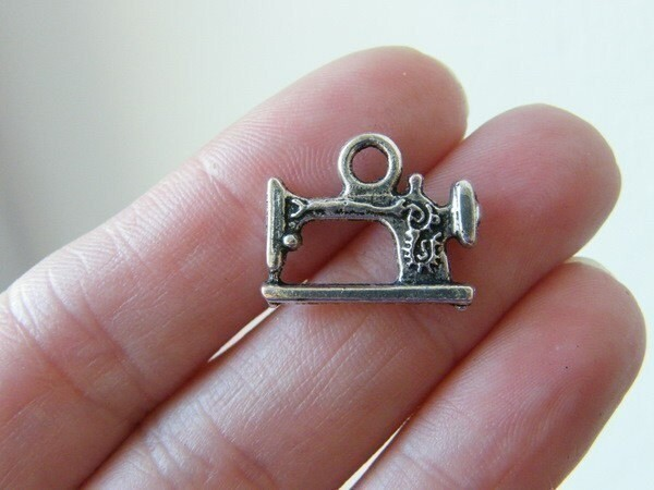 BULK 30 Sewing machine charms antique silver tone SN43