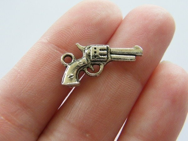 10 gun charms antique silver tone G1