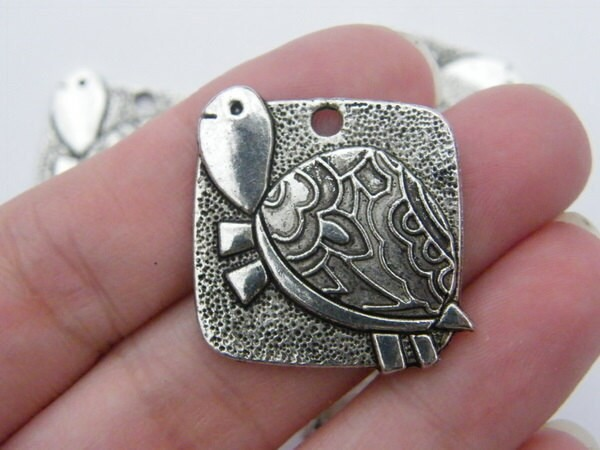 4 Tortoise pendants antique silver tone FF134