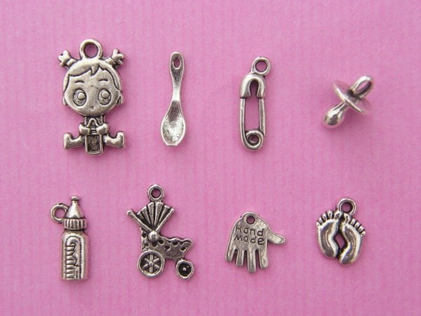 The Baby Girl Collection - 8 different antique silver tone charms