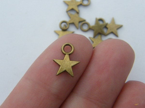 BULK 50 Star charms antique bronze tone S12
