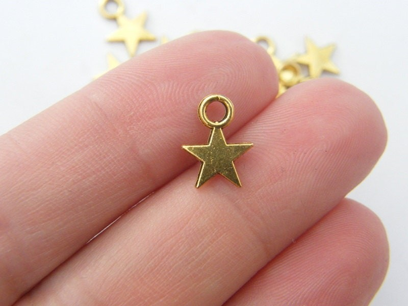 BULK 50 Star charms antique gold tone S13
