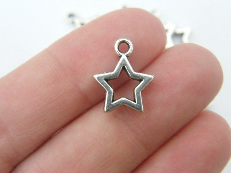 12 Star charms antique silver tone S1