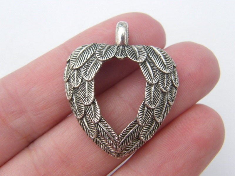 2 Wing pendants antique silver tone AW44