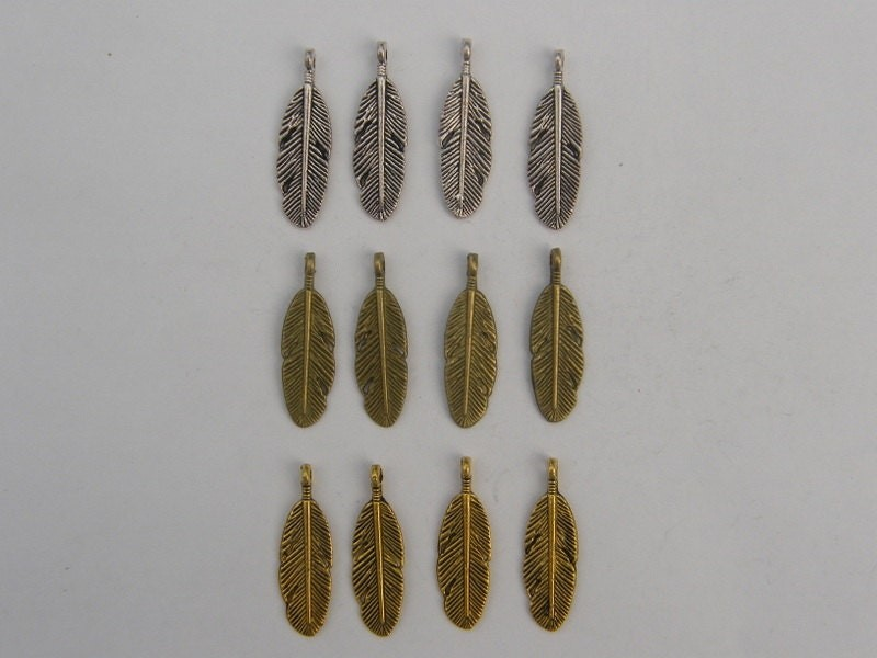 The Feather Collection - 12 silver, bronze and gold tone feather charms