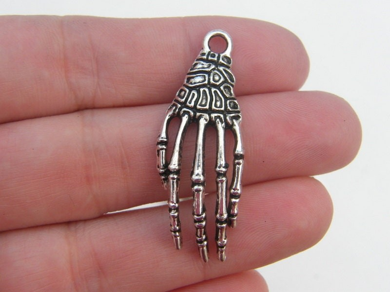 BULK 30 Skeleton hand charms antique silver tone HC118