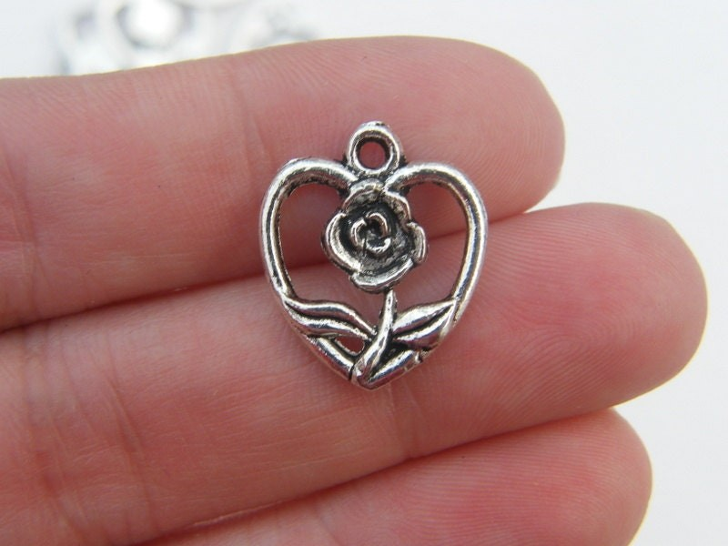 10 Rose heart charms antique silver tone H14