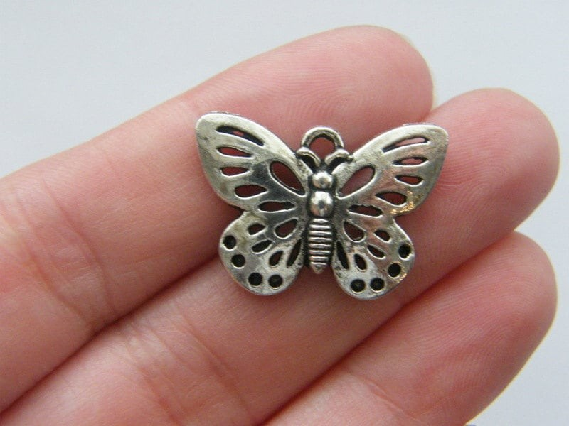 5 Butterfly charms antique silver tone A354