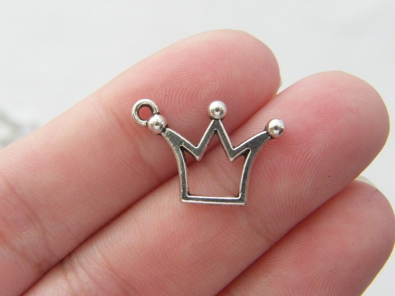 14 Crown charms antique silver tone CA10