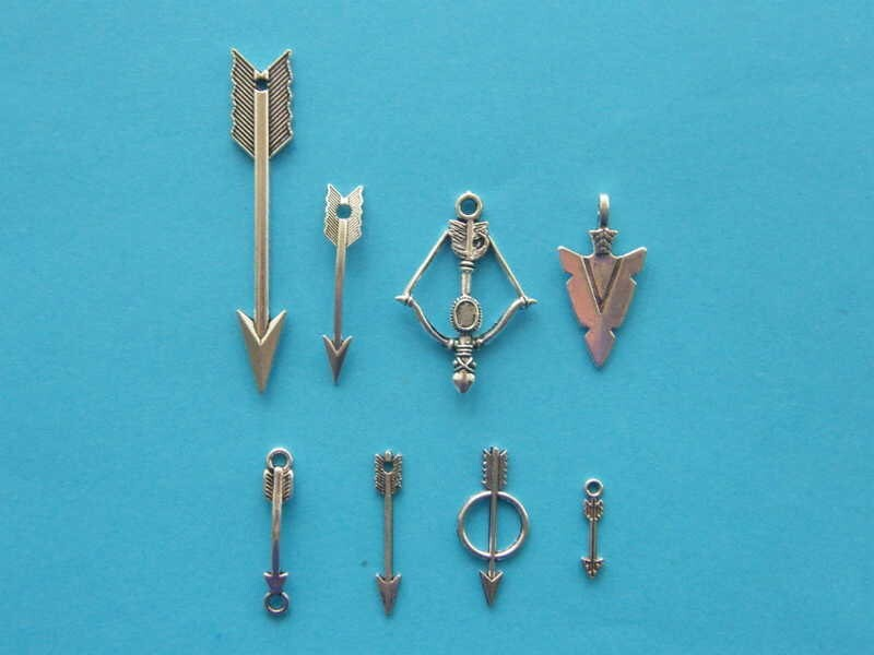 The Arrow Collection - 8 different antique silver tone charms
