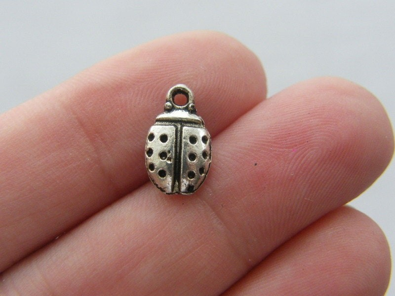 18 Ladybug charms antique silver tone A126