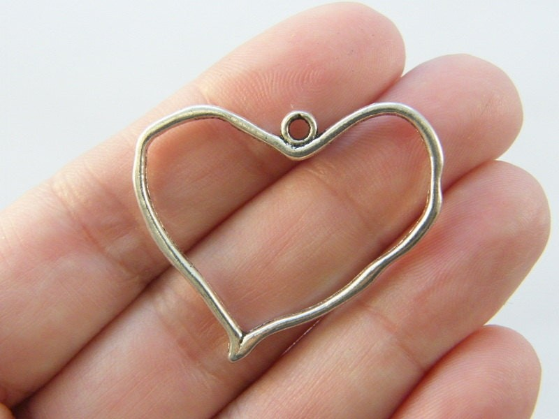 4 Heart charms antique silver tone H108