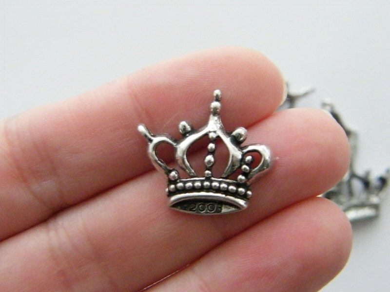 8 Crown charms antique silver tone CA8