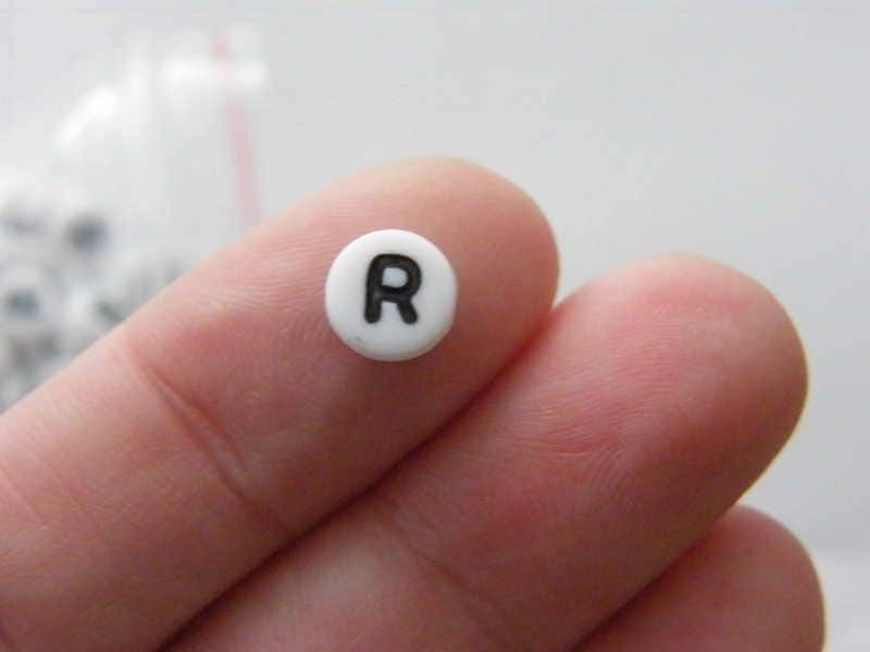 100 Letter R acrylic round alphabet beads white and black