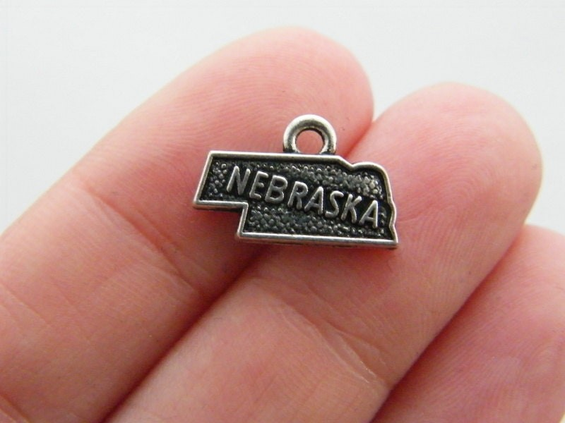 4 Nebraska charms antique silver tone WT150