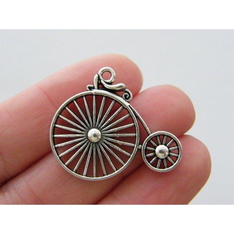 4 Penny farthing bicycle antique silver tone TT109