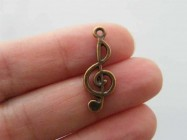 12 Music note charms antique copper tone CC33