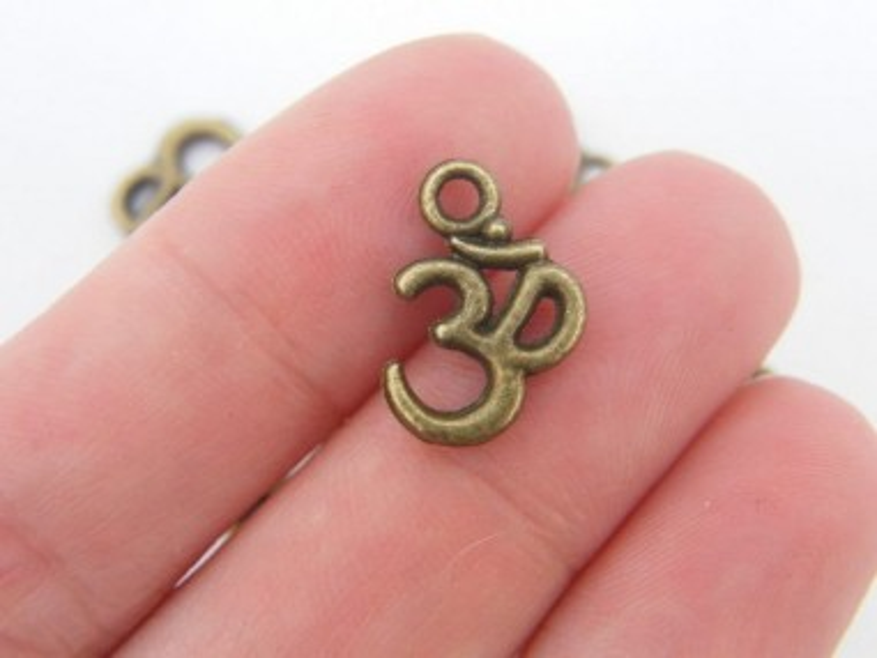 12 OM charms antique bronze tone BC269