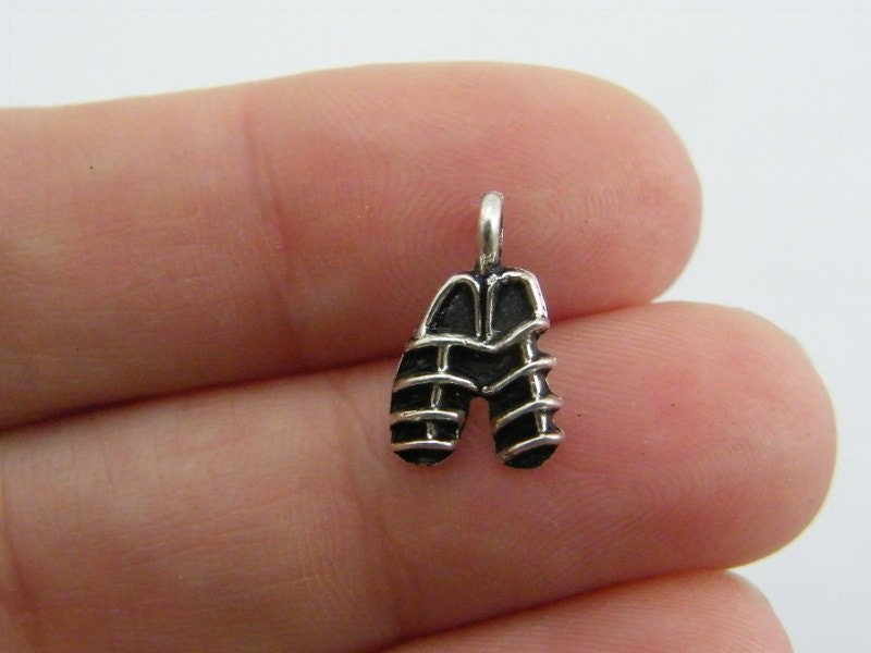 14 Sandal charms antique silver tone CA55