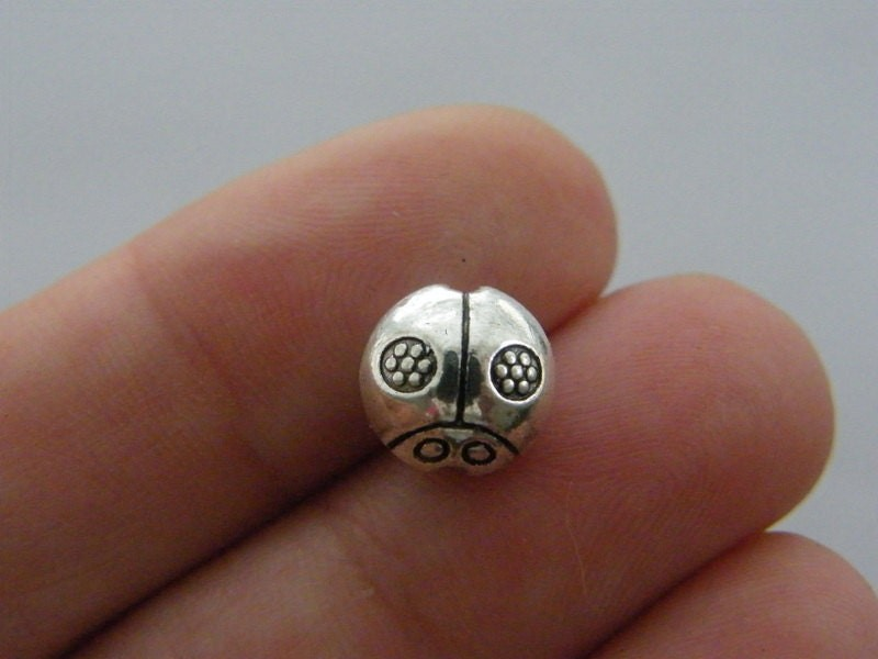 10 Ladybug spacer beads antique silver tone A812
