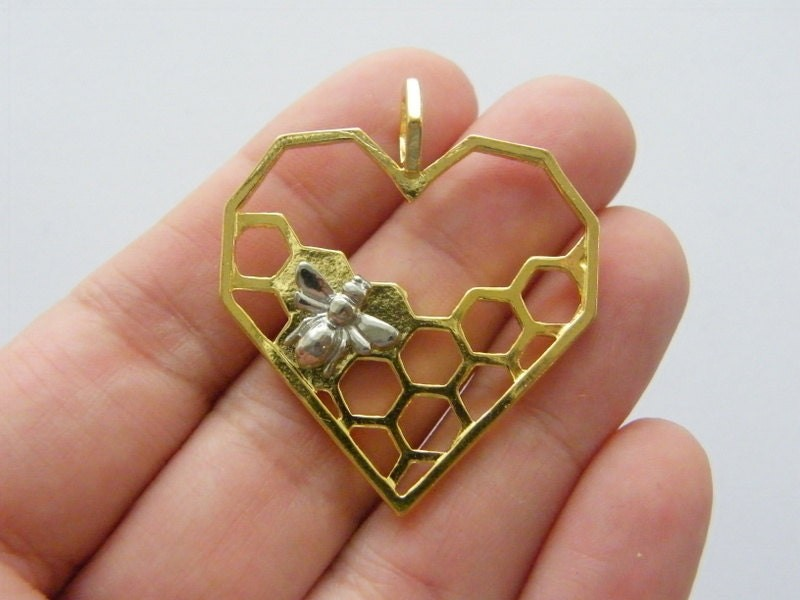 2 Bee and honeycomb  charms silver and gold tone A19