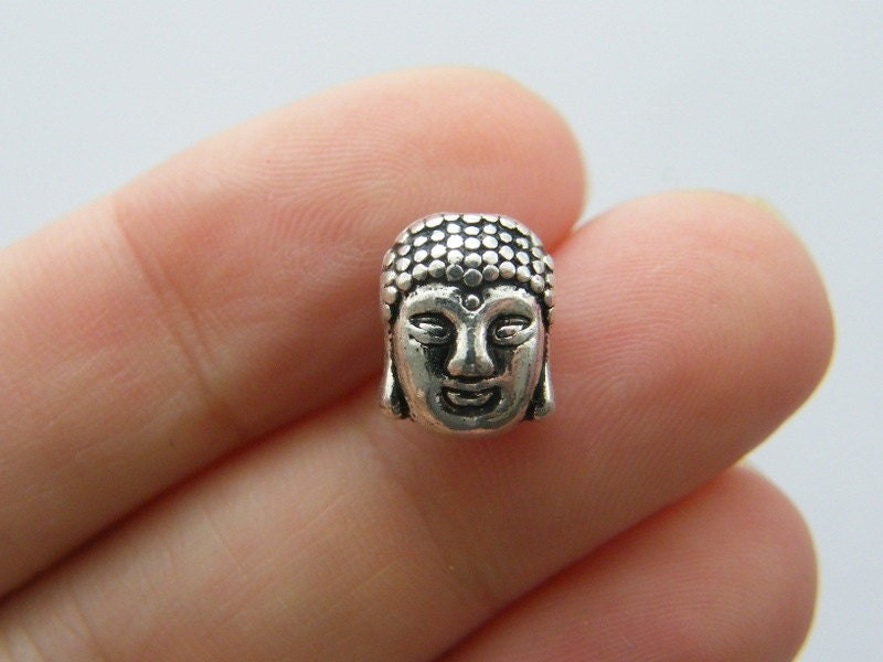 8 Buddha spacer beads antique silver tone R74
