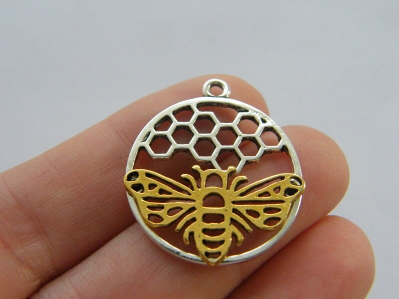 4 Bee and honeycomb  charms silver and gold tone A631