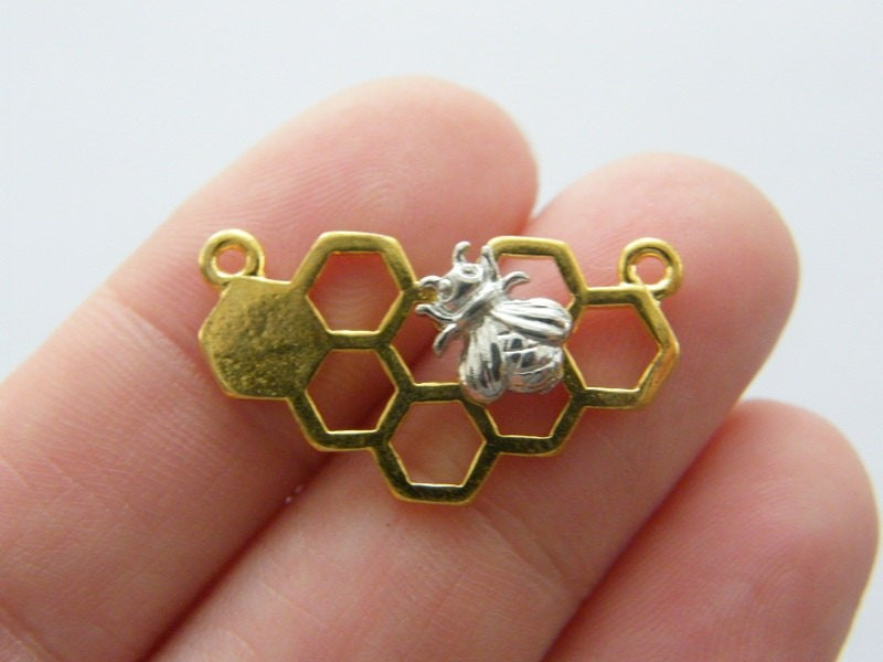 4 Bee and honeycomb connector charms silver and gold tone A376