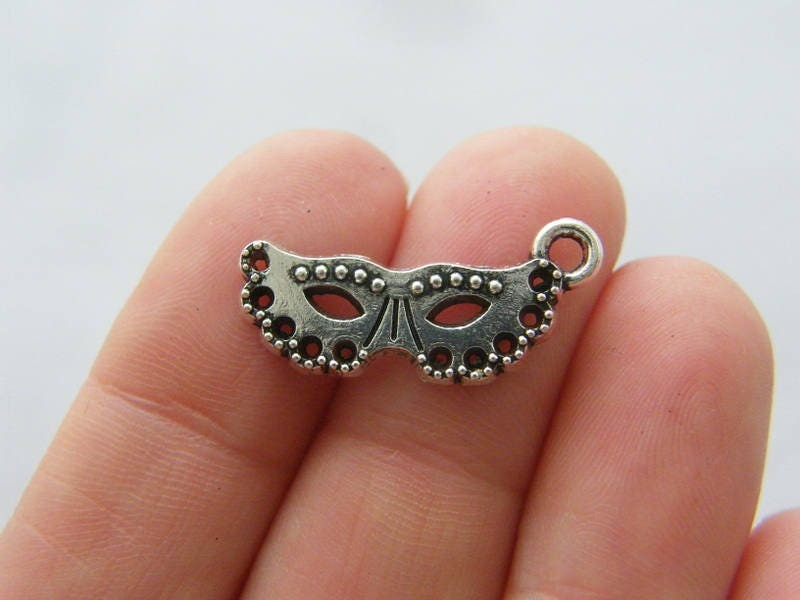 8 Mask charms antique silver tone CA124