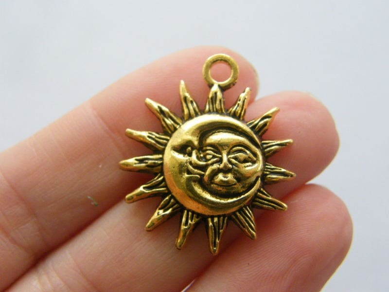 4  Moon and sun pendants antique gold tone GC297