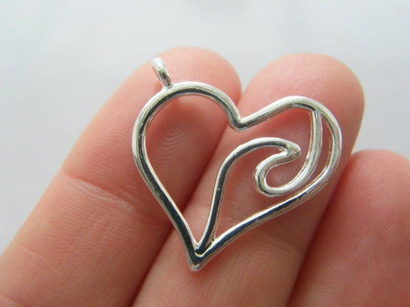 4 Wave heart charms silver plated tone SC138