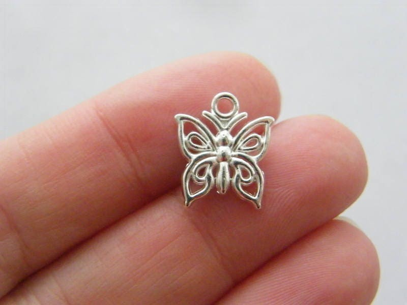 12 Butterfly charms silver plated tone A515