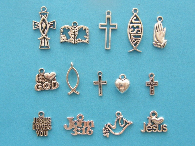 The Religious Collection - 14 different antique silver tone charms