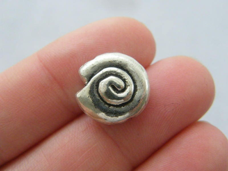 8 Shell spacer beads antique silver tone FF371