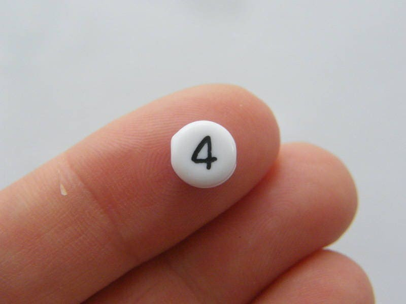 100 Number 4 acrylic round number beads white and black