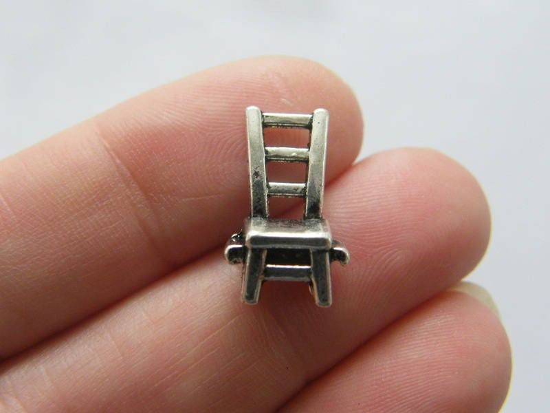 8 Chair charms antique silver tone P49