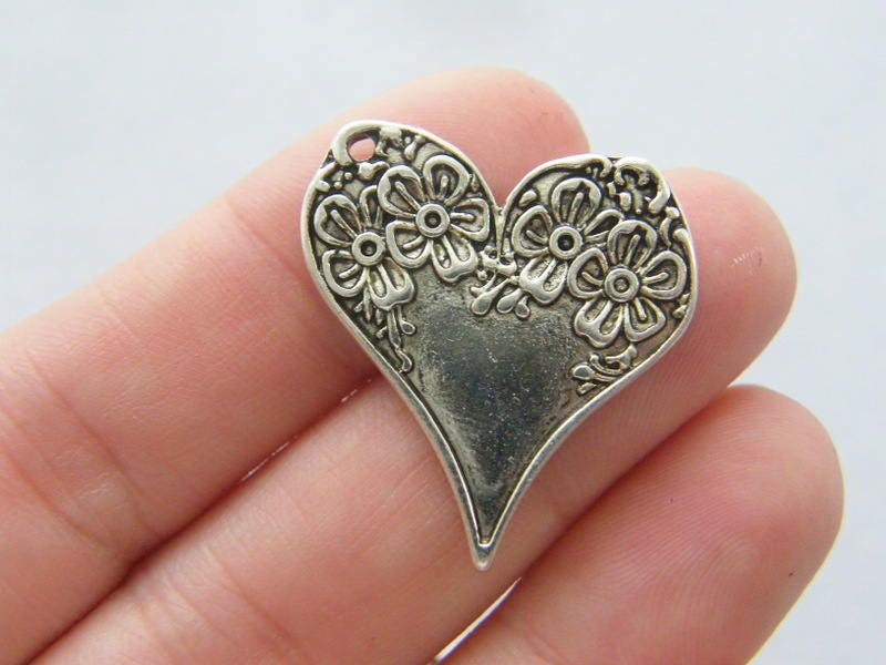 4 Heart charms antique silver tone H46