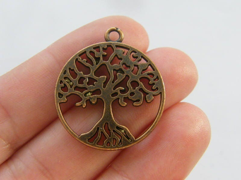 6 Tree pendants antique copper tone CC44