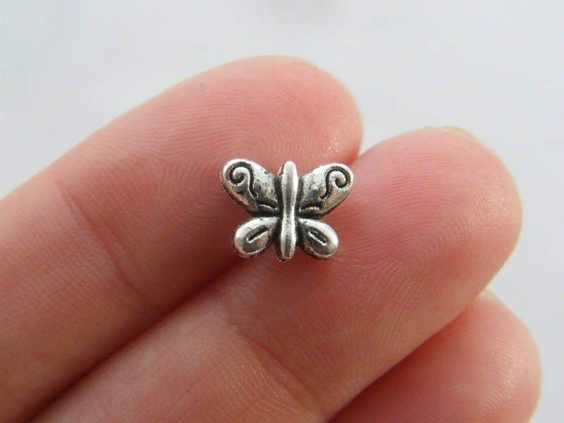 14 Butterfly spacer beads antique silver tone A732