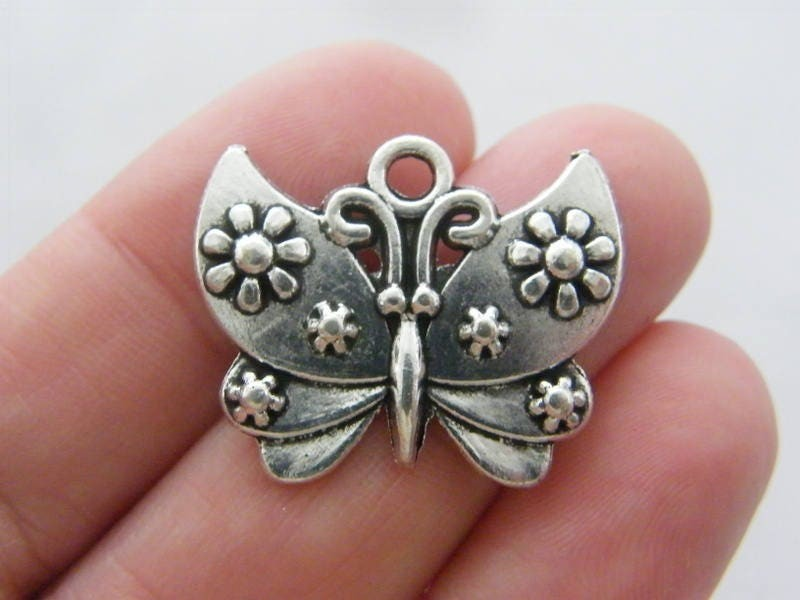 6 Butterfly charms antique silver tone A518