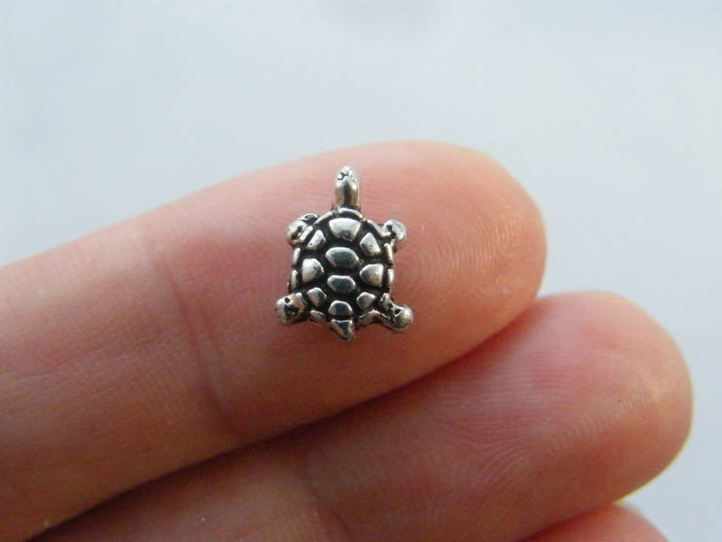 12 Tortoise spacer bead charm antique silver tone FF419