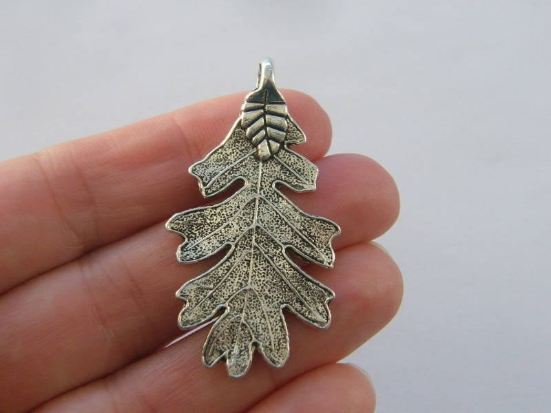 4 Leaf charms antique silver tone L106